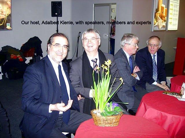 Our host Adalbert Kienle, with speakers, members and experts