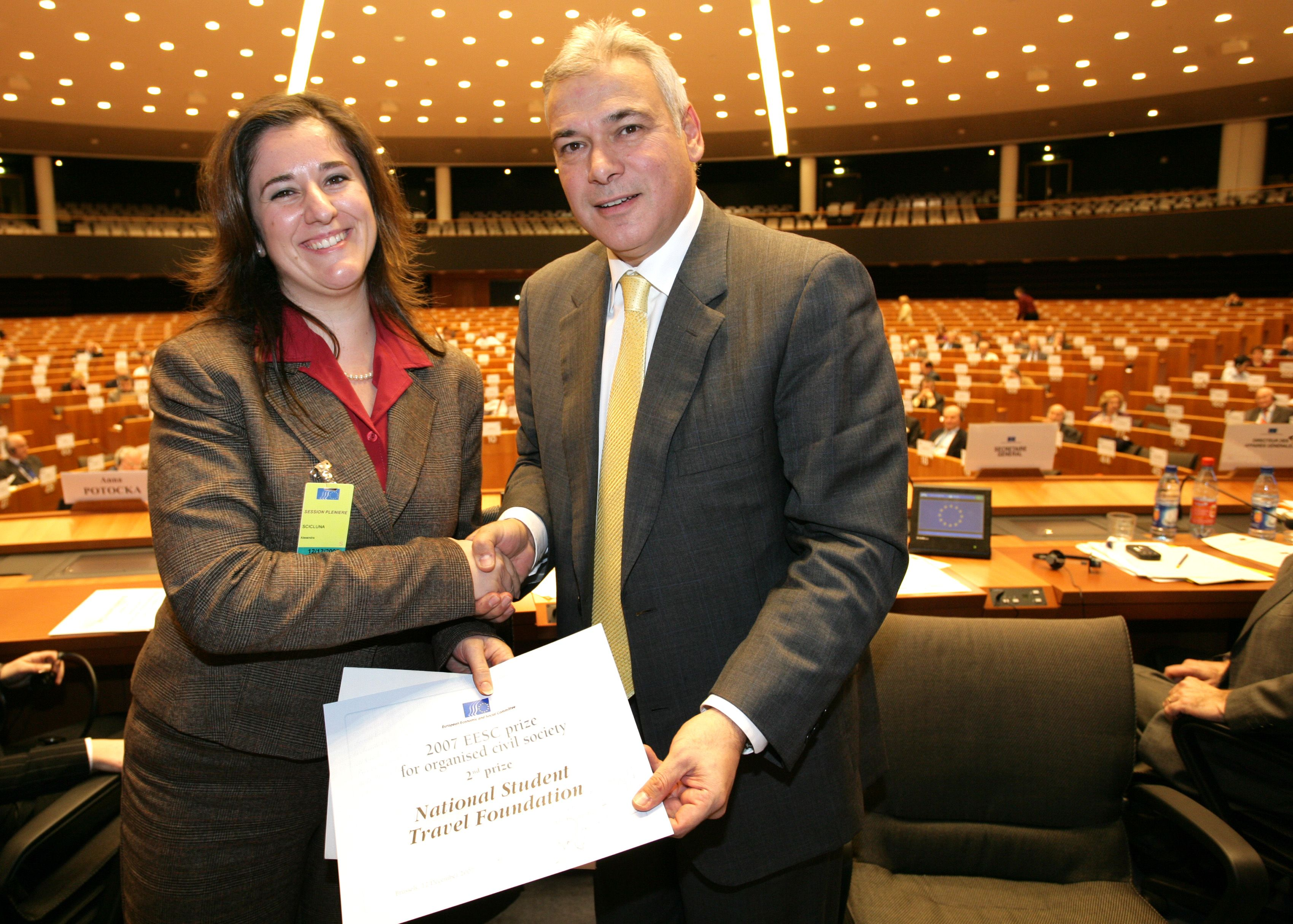 Alexandra Scicluna, National Student Travel Foundation,   Malta, receiving the 2nd   prize ex aequo from EESC President Dimitris Dimitriadis