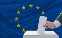 Hand voting over a eu flag